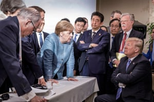 G7 leaders including German chancellor Angela Merkel and Japanese prime minister Shinzo Abe in discussion with President Donald Trump during the second day of their summit