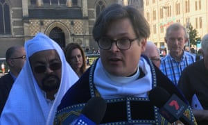 Dean Andreas Loewe, flanked by Islamic Council of Victoria president Mohamed Mohideen, speaks to the media outside St Paul's Cathedral in Melbourne on Saturday