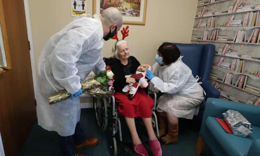 Mary Orme (right) and her son Michael McKimm greet their mother and grandmother, Rose McKimm, during a Christmas Day visit at Aspen Hill Village care home in Hunslet, Leeds.