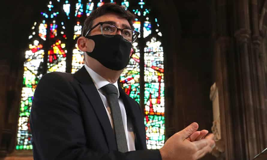 Andy Burnham, mayor of Greater Manchester, sanitises his hands before a memorial service for the victims of coronavirus at Manchester Cathedral in July.