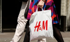 Woman carrying H&M carrier bag