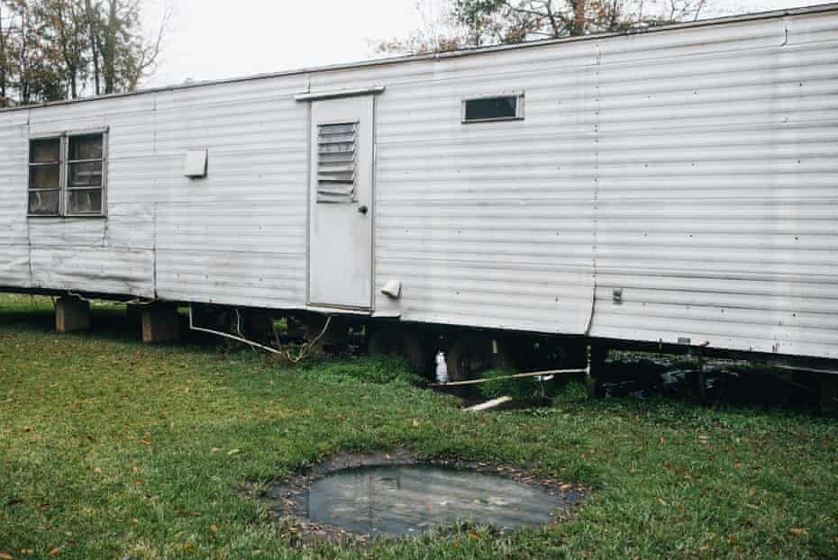 "A mobile home using ""straight pipe"" sits a few feet away from a pool of raw sewage. Inadequate sewage treatment has plagued Alabama's poor Black Belt community for decades, often leading to problems of overflow and contamination of the area's water supply."