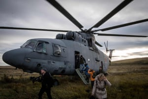 Foreign journalists disembark from a Russian army helicopter at Tsugol training ground in Siberia