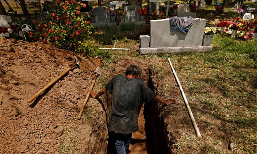 Jesus Torres, age 75, was hired to dig graves after the backhoe broke down at La Piedad cemetery in McAllen, Texas this July.