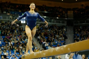 Kyla Ross of UCLA smiles as she competes on the balance beam during a meet against Stanford at Pauley Pavilion in March 2019.