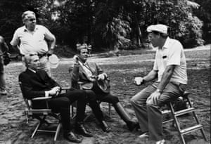 Christopher Walken, Albert R. Broccoli, Roger Moore and director John Glenn on the set of A View to a Kill, 1985