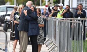 President Joe Biden hugs Miami-Dade County Mayor Daniella Levine Cava.