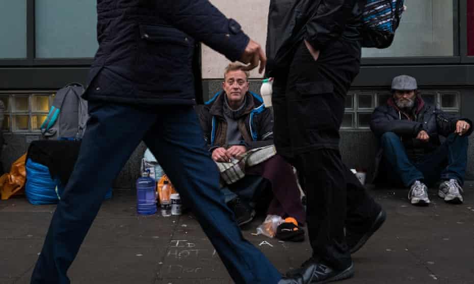 Homeless man begs in London