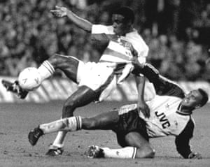 QPR's Paul Parker shrugs off a challenge from Arsenal's David Rocastle in an FA Cup replay in February 1990.