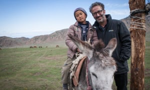 Baddiel with a local boy in a nomad village in Kyrgyzstan.