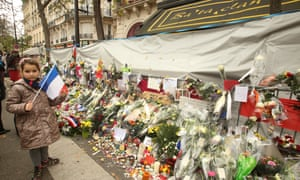 National Tributes For The Victims Of The Paris Terrorist Attacks<br>PARIS, FRANCE - NOVEMBER 27: People with the French Tricolore flag at the 'Bataclan' concert hall in memory of the 130 victims of the Paris terrorist attacks on November 27, 2015 in Paris, France. French President Francois Hollande called on all French citizens to hang the tricolore national flag from their windows to pay tribute to the victims of the terrorist attacks. (Photo by Patrick Aventurier/Getty Images)