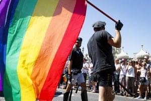 S&M cop with rainbow flag