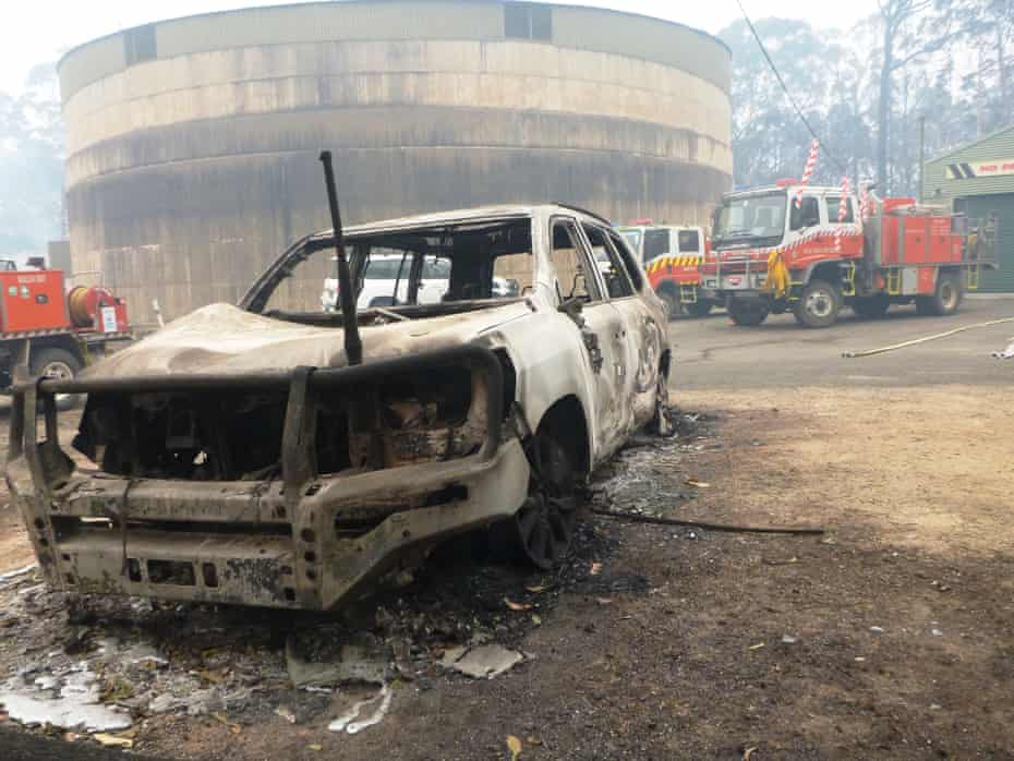 A burnt-out car in front of the Malua Bay RFS building