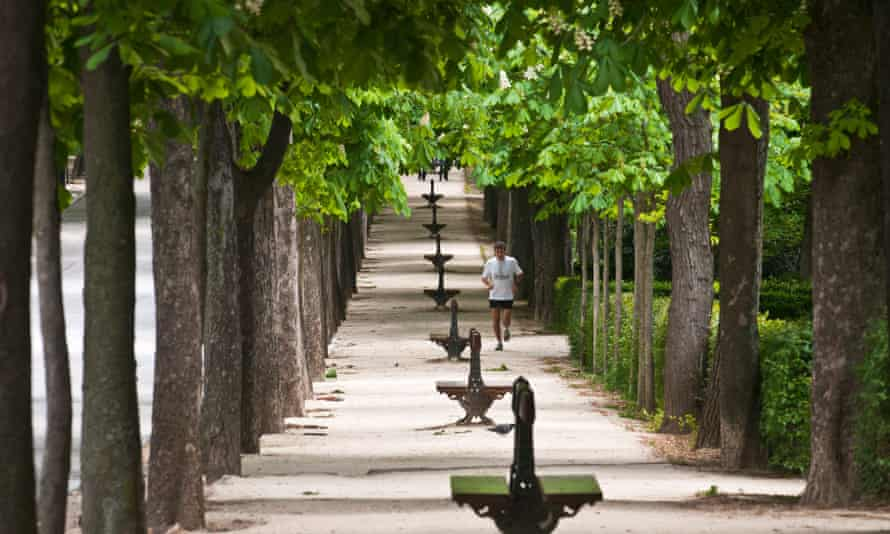 A man jogs in Retiro Park, Madrid, Spain.