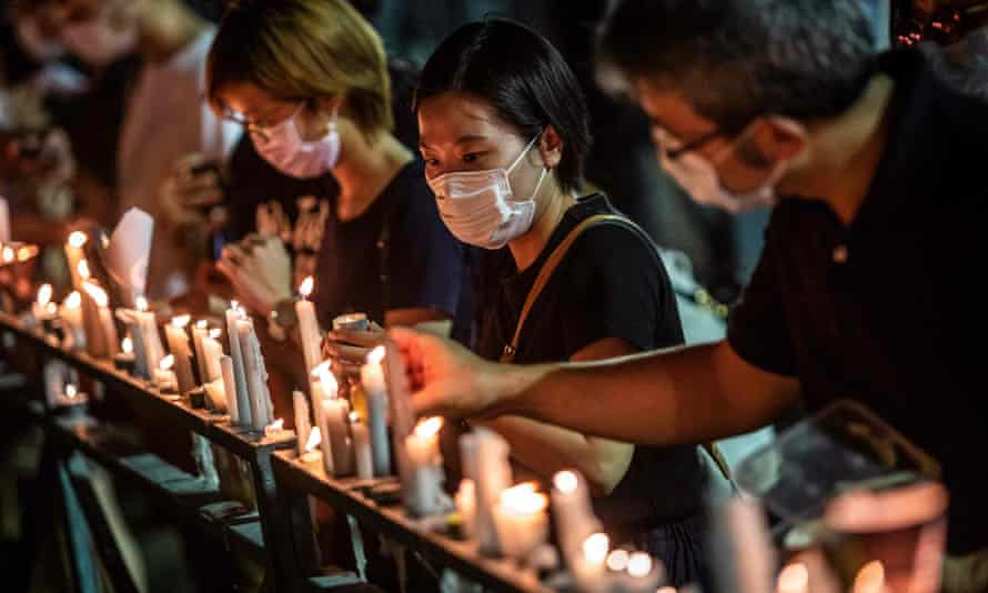 People in Hong Kong attend a candlelit vigil at Victoria park in 2020 to mark the 1989 Tiananmen Square massacre. Such events could now fall foul of the national security law.