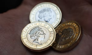 The new 12-sided £1 coins have extra security features.