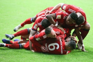 Rafinha is swarmed by his teammates after scoring