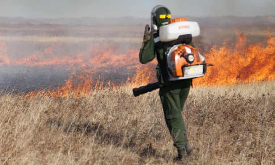 Local volunteer Andrey Polomoshnov suppresses grass fires in Zabaikalsky region, Siberia, Russia.