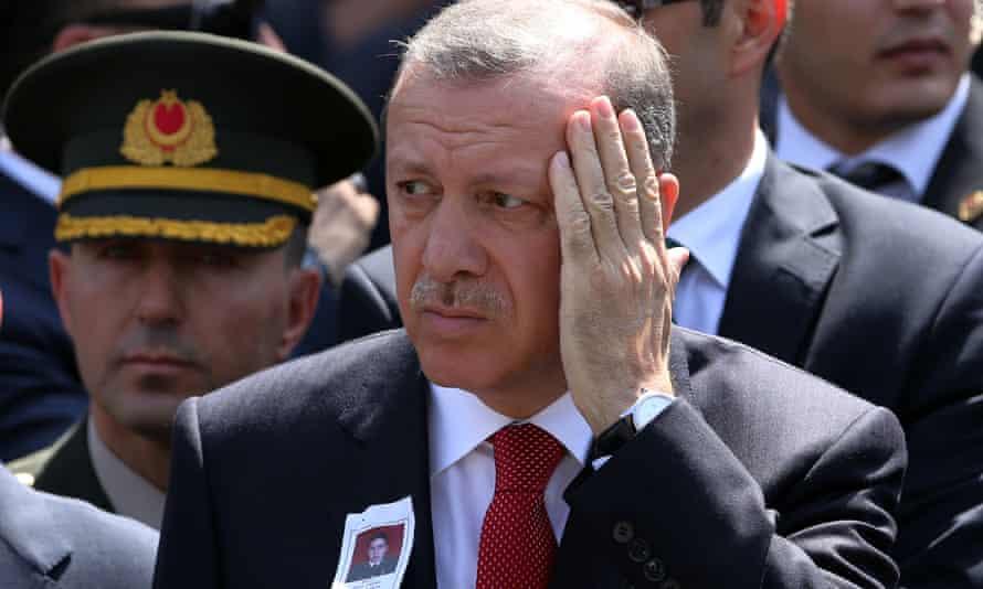 Turkey's president, Recep Tayyip Erdogan, at funeral prayers on 10 September for Okan Tasan, a Turkish army officer killed in a Kurdish rebel attack.