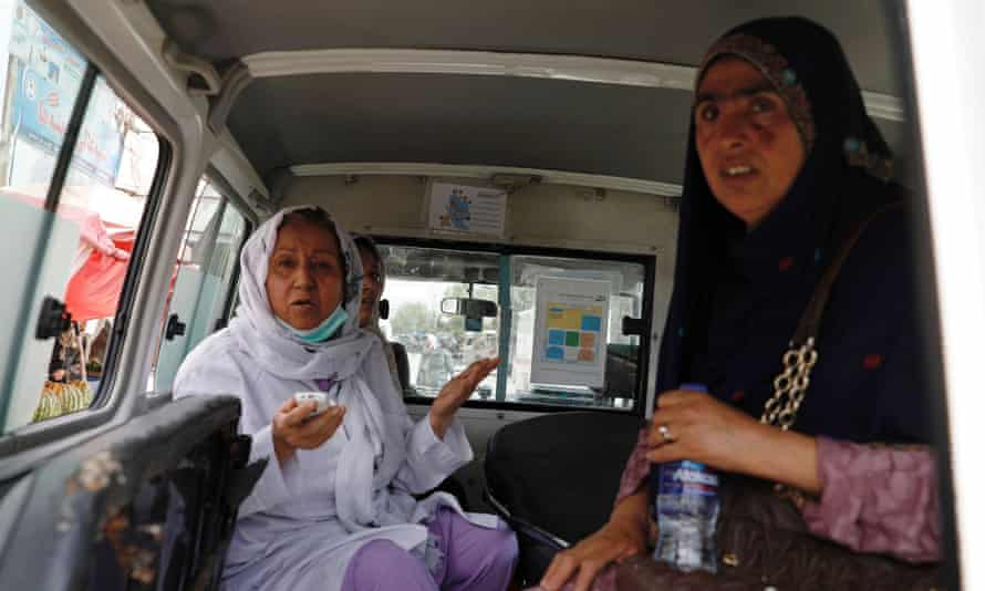 Afghan women sit in an ambulance after being rescued by security forces during the hospital attack.