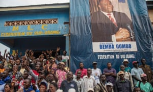 Supporters of former warlord Jean-Pierre Bemba gather in front of the party's office in Gemena.