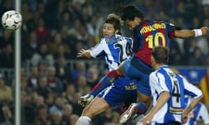 Mauricio Pochettino, seen here in 2004 playing for Espanyol, can only watch as Barcelona's Ronaldinho plants a header into the top corner.