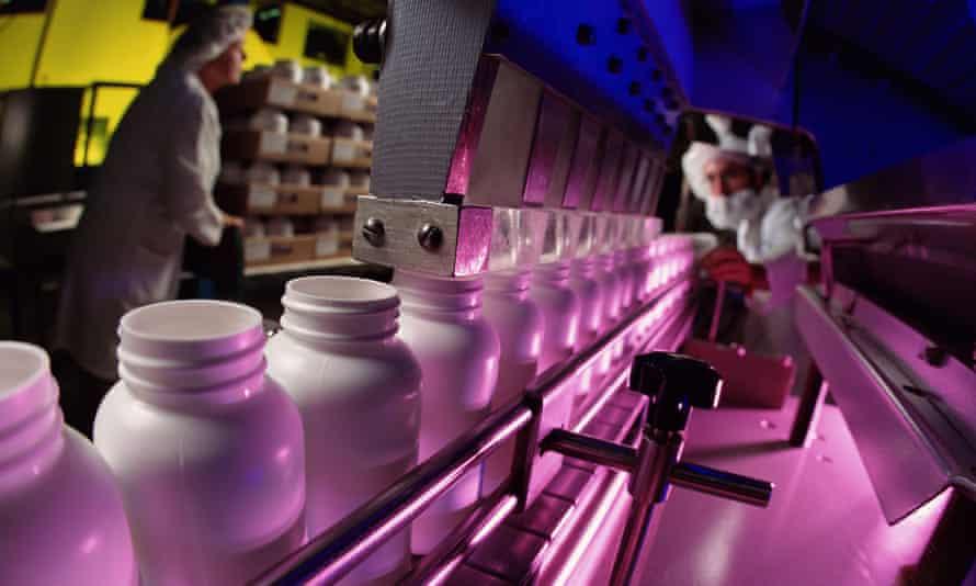 An assembly line of pill bottles.