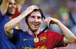 Lionel Messi of Barcelona celebrates with his winner's medal at the 2009 Champions League final.