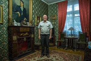 Vladimir Komarov, a retired government worker stands proudly inside his soon to be demolished home. He has suffered from heart problems after finding out he is to be evicted