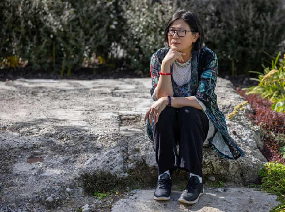 Quin Tang, survivor of the CTV building collapse in the 2011 Christchurch earthquake, pictured sitting in the ruins of of the CTV building