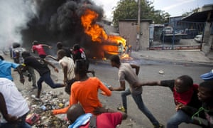Demonstrators flee police gunfire during protests in Port-au-Prince demanding the resignation of Jovenel Moise, the Haitian president