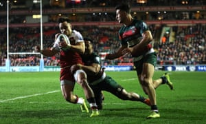 Tom Collins of Northampton breaks through for his second try against Leicester at Welford Road.