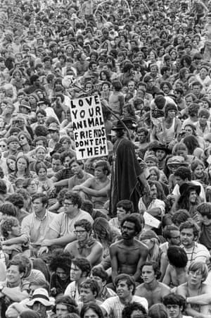 Woodstock Music & Art FairA man holds a pro-vegetarian poster amongst the crowd at the Woodstock Music & Art Fair, Bethel, NY, August 15, 1969.