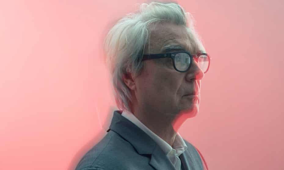 David Byrne in profile with dark-rimmed glasses