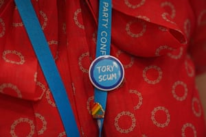 A delegate wearing 'Tory scum' badge at the Conservative party conference.