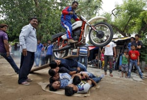 Ahmedabad, India Hindus rehearse a motorcycle stunt ahead of the annual Rath Yatra procession, which takes place on 18 July
