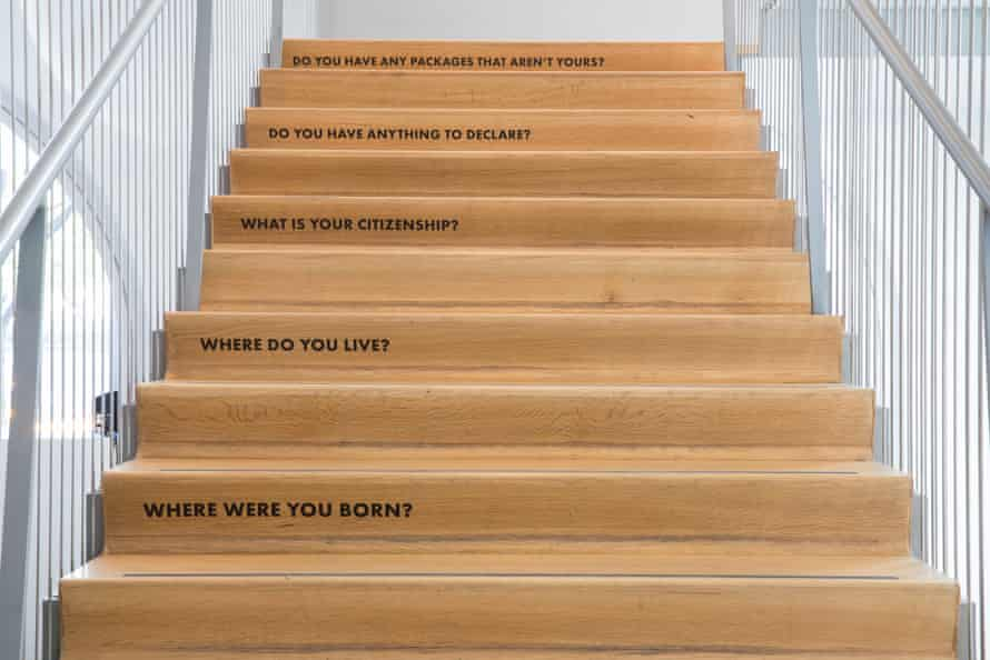 Tanya Aguiñiga's exhibit includes a staircase with questions asked to border-crossers.