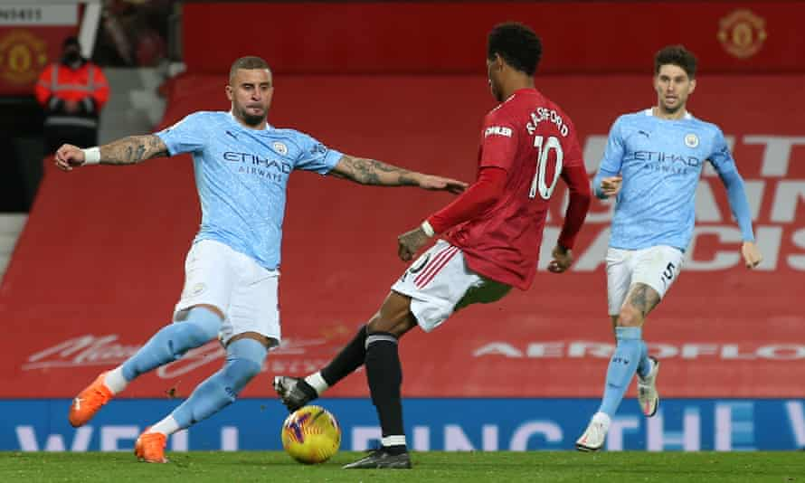 Kyle Walker of Manchester City (left) challenges Marcus Rashford of Manchester United