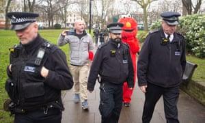 An Elmo with a police escort.