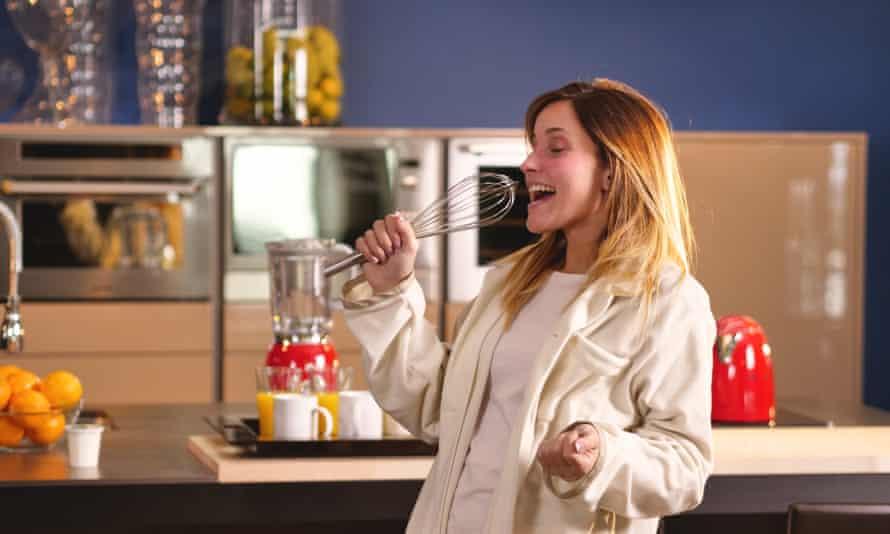 Woman singing in her kitchen