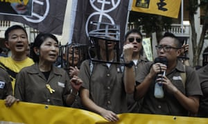 People march in support of the imprisoned pro-democracy leaders in Hong Kong.