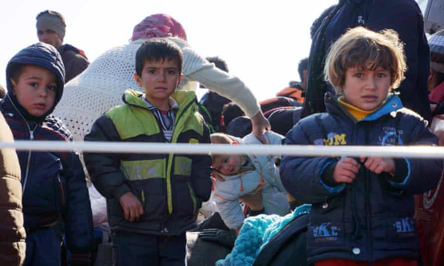Refugee children arrive at Lesbos on a Greek coastguard boat.