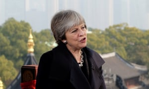 Theresa May speaks to the media in Shanghai.