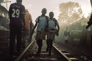 Two friends from Olympic primary school walk home along Kibera's train track.