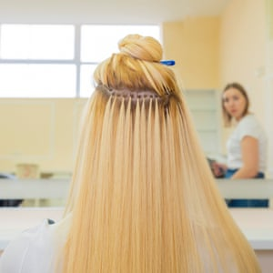 A view from the back of Anna's head showing how the extensions are glued in.