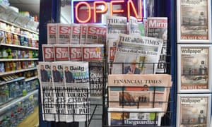 Newspapers in a display stand