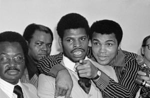 Muhammad Ali embraces heavyweight champion Leon Spinks during a news conference on 12 April 1978 in New Orleans after they signed to fight in the Superdome.