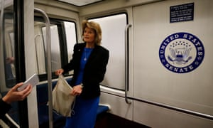 Republican senator Lisa Murkowski speaks with the media as she boards the US Capitol subway system on Wednesday.