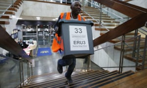 Ballot boxes are delivered for counting in the Lewisham East byelection.
