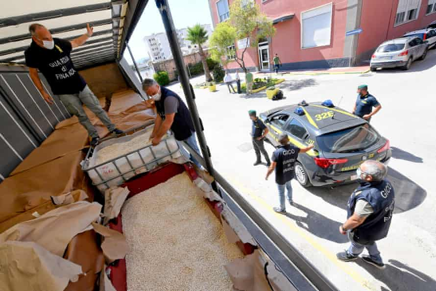 Naples law enforcement officers inspect a huge seizure of Captagon tablets in Salerno in July 2020.